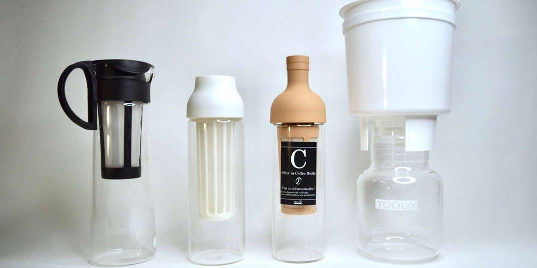 The Hario Mizudashi, Kinto Capsule, Hario Wine Bottle, and Toddy Cold Brew maker in a line