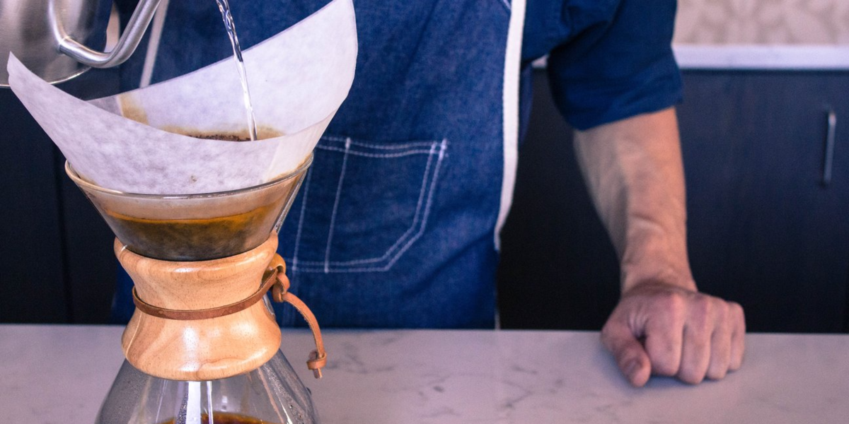 Brewing coffee on a Chemex coffee maker