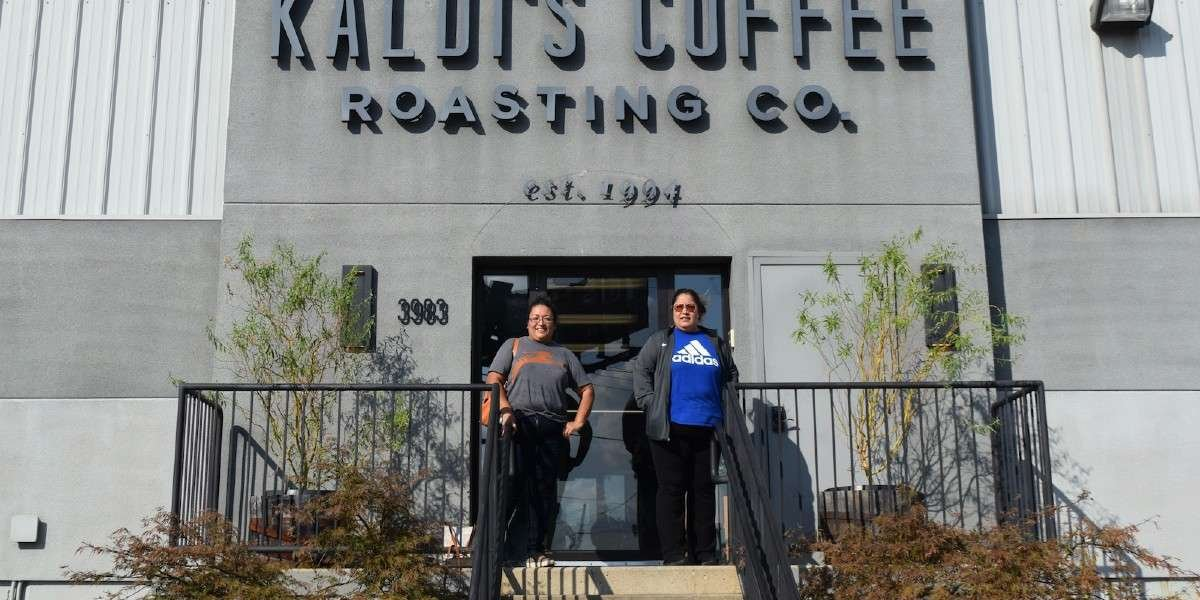 Lupe and Maria standing outside the Kaldi's Coffee Roastery in St. Louis, MO