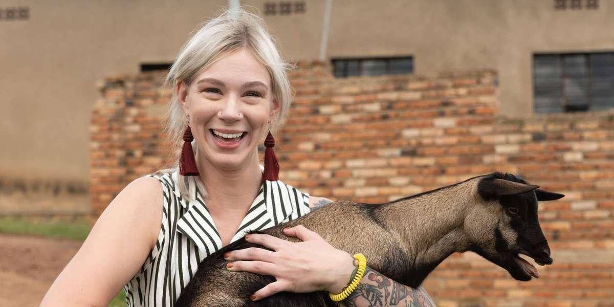 Kiersten holding a goat in Rwanda