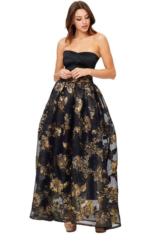 This is a beautiful long navy lace skirt with gold detail. This is a great long flowy skirt to match your party top. Perfect for a holiday party, christmas party, or new years outfit!