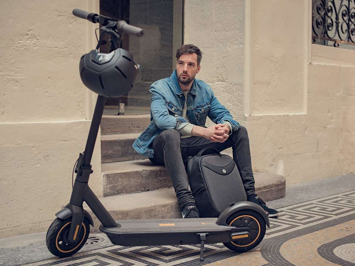 Segway ninebot max electric scooter back pack business man