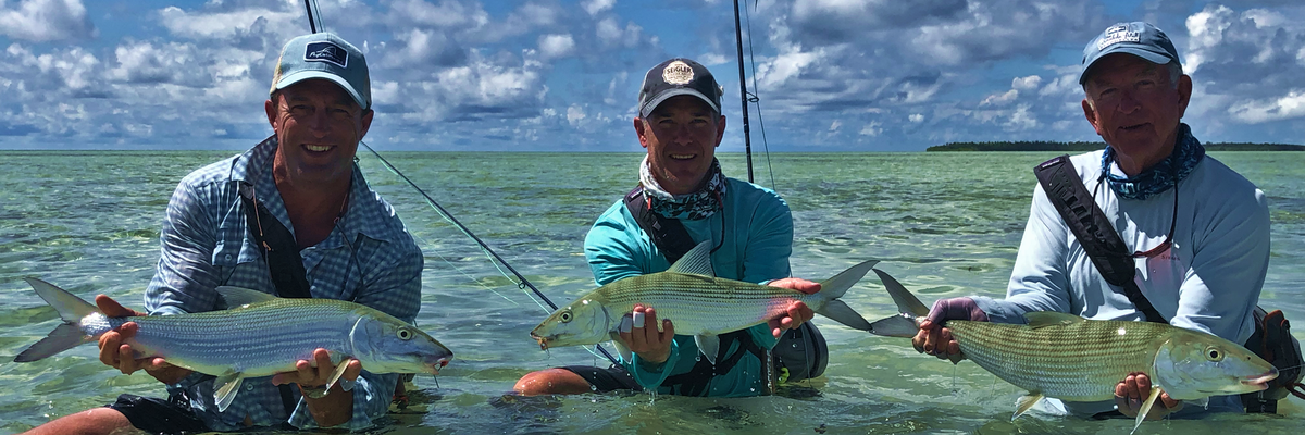 Wes Seigler Lake Taylor Bill Taylor all hooked up and holding their proper bonefish for picture. Flats fishing at its best in the seychelles. Bonefishing Triggerfishing flyfishing