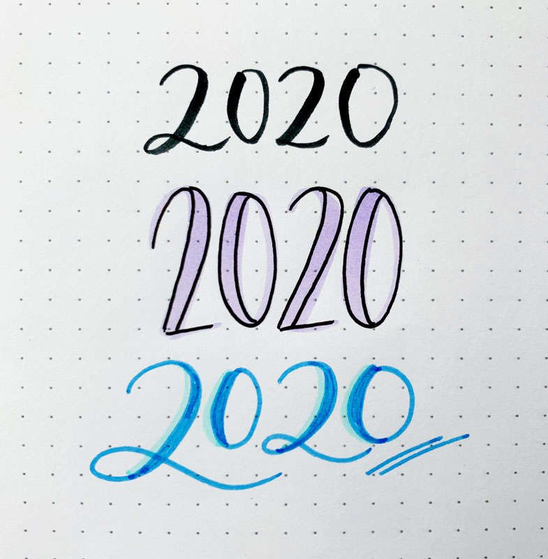 the numbers 2020 written in three different font styles