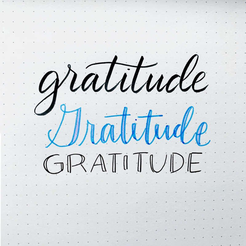 the word gratitude written in three different font styles