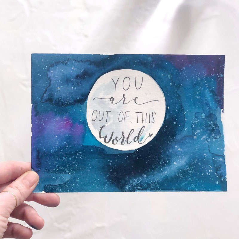 "watercolor painting of a night sky and moon that says ""You are out of this world"""