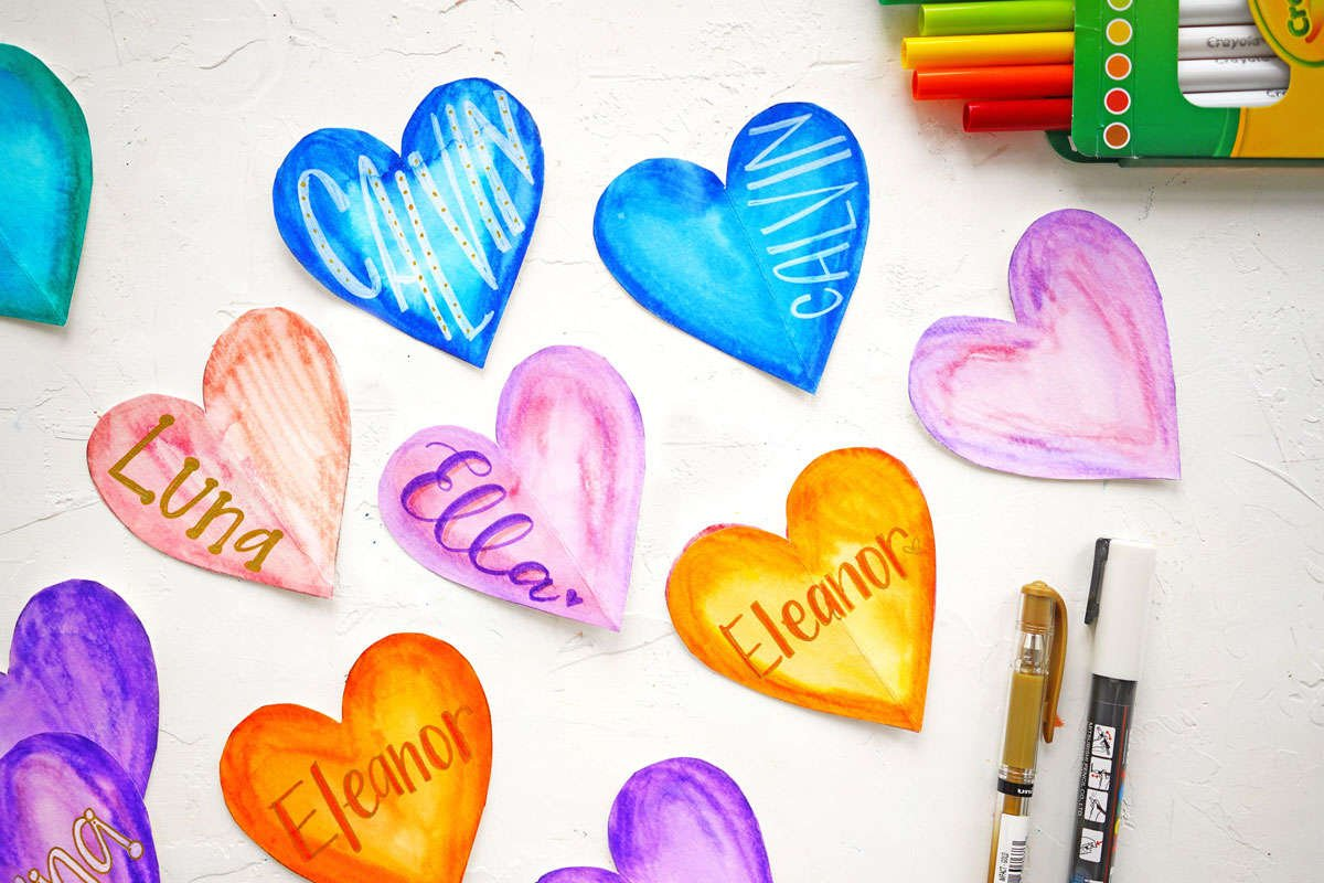 a display of decorated paper hearts featuring the supplies used