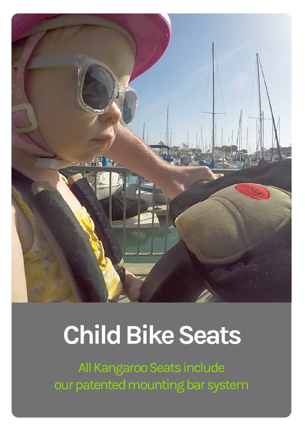 Child Bike Seats - All Kangaroo Seats include our patented mounting bar system - Cool litle girl in sunglasses with a closeup of her weeride pad, biking with her dad on a boat dock pier