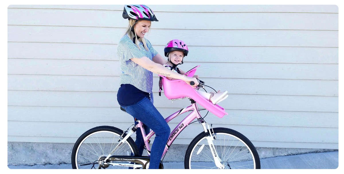 Cool, Fun Mom on Pink Kent Pomona with Pink iBert Safe-T-Seat smiling - Matching Pink Capstone Helmets