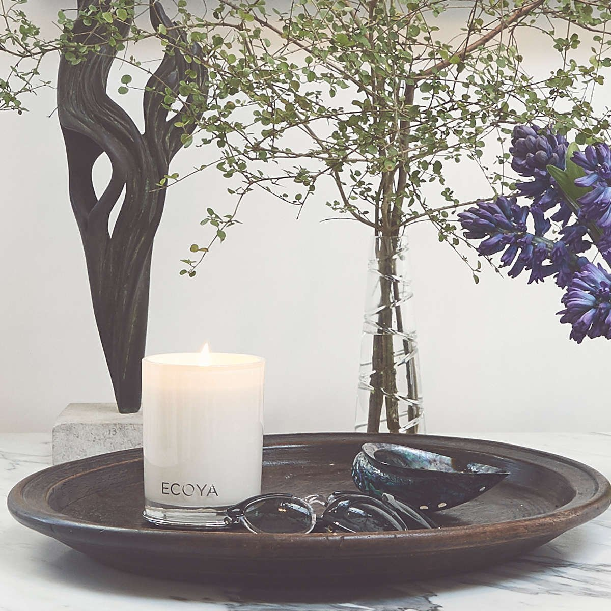 ECOYA candle, sunglasses and flowers in Mimi Gilmour-Buckley's home