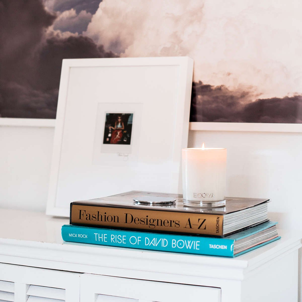 Candle and books in bedroom
