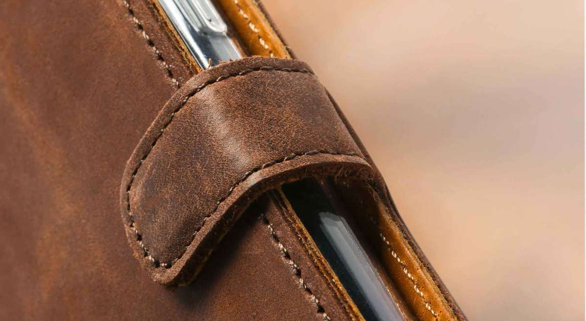 Close up of the leather wallet case stitching