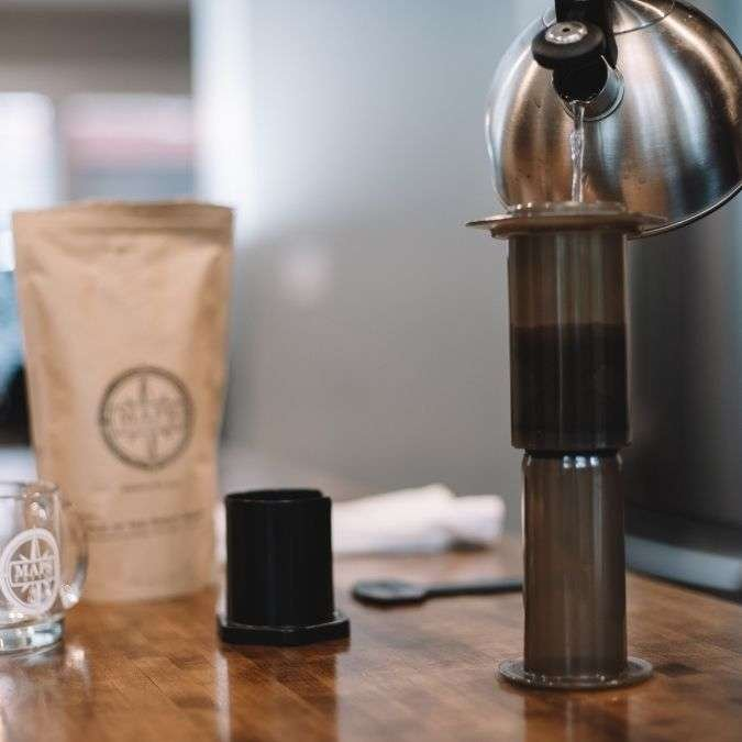 Water being poured into an Aeropress