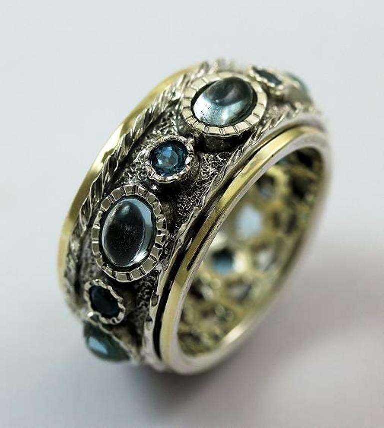 spinner ring blue topaz