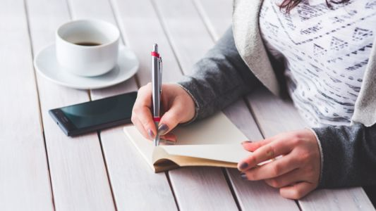 Woman writing in a journal
