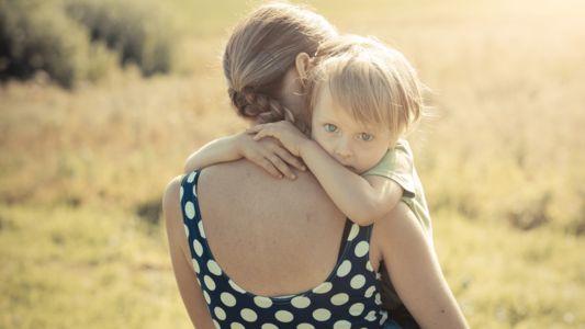 Caucasian Woman Holding Child