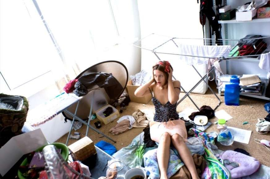 Woman at center of messy room