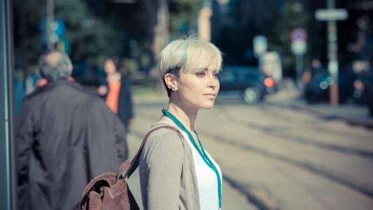 Woman Staring into Traffic Waiting