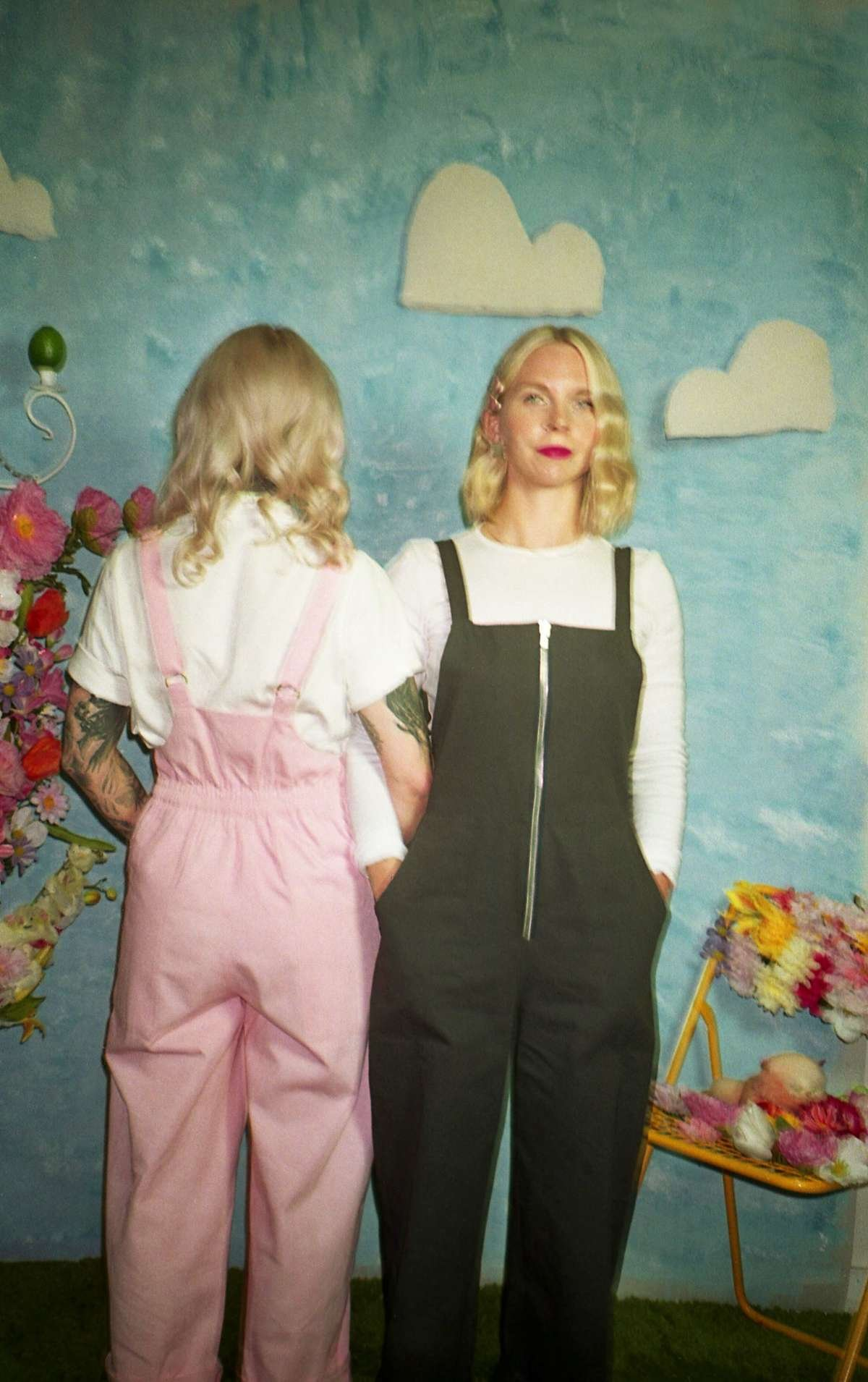 maggie jayne clothing warm weather collection asphalt and pink dungarees photograph by Heather Rappard of Brumwell twins on an indoor picnic