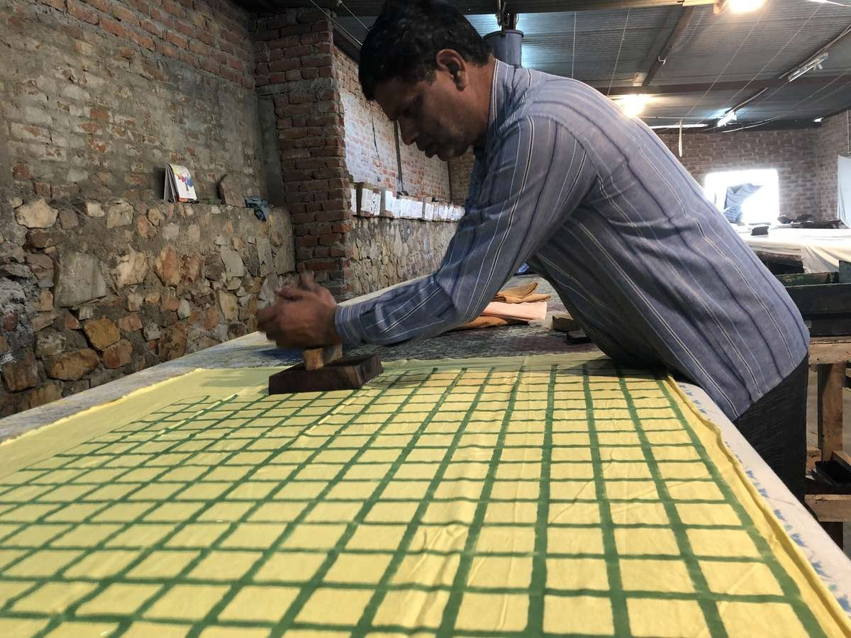 Artisan in Jaipur blockprinting maggie jayne organic cotton