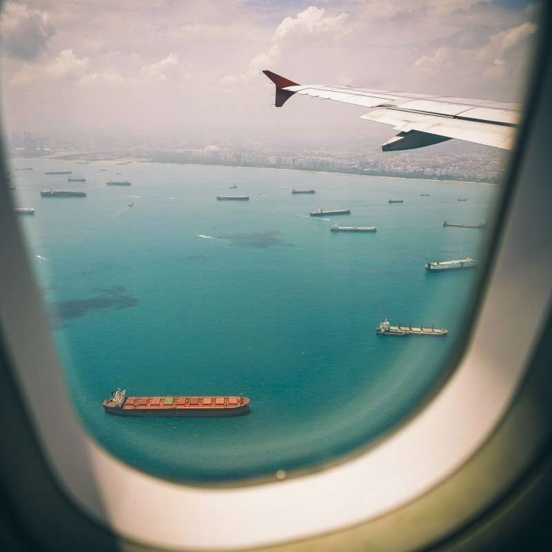 airplane window with the sea below