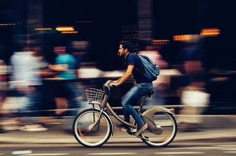 Man on bike in city