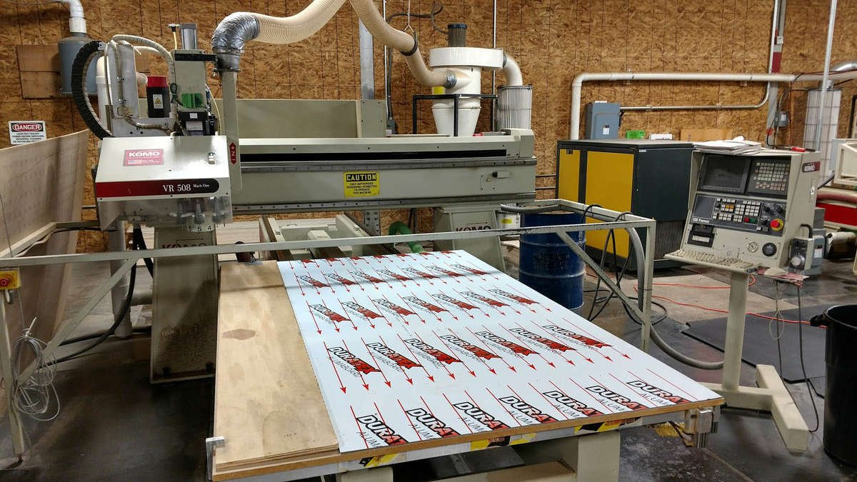 A CNC router capable of wood routing and metal cutting